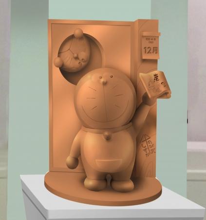 高岡の伝統産業である「高岡銅器」で制作した、ドラえもん像を展示